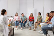 canvas print picture Group of pregnant women with men and doctor at courses for expectant parents indoors