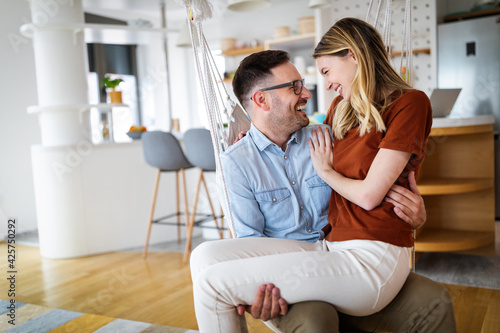 Fotografie, Tablou Cute couple in love hugging and having great time together at home