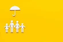 Family Figure Under Umbrella. Insurance And Family Protection Concept