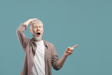 Promotion Concept. Shocked Albino Guy Pointing Aside At Free Space, Recommending Something On Blue Studio Background