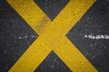 Yellow Lines On Asphalt, Yellow Crossing Lines, Like A X On A Dark Grey Road, Space For Text, No Person