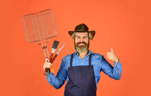 Food And Barbeque. Hipster Hold Cooking Utensils For Barbecue. Bearded Man Chef. Tools For Roasting Meat Outdoors. Picnic And Barbecue. Ready For Barbecue Party. Culinary Concept. Summer Weekend