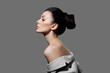 Leinwandbild Motiv Perfect face profile woman, natural cosmetics for face care. Portrait of a fashion woman with a bunch of hair
