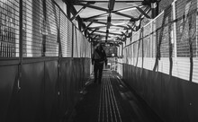 Black And White Photo Of The Silhouette In The Tunnel
