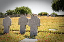 World War 2 German Cemetary. Monument Dedicated To The Fallen Enemy Soldiers. Grey Stone Crosses In The Graveyard On A Sunny Day In Chania, Crete Island, Greece