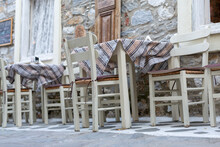 White Chairs And White Tables In Traditonal Greek Style