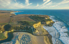 Aerial View Of California Pacific Coast With Beautiful Beach And Sunny Sky, Sand, Rocks And Ocean Waves.