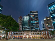 Night Scenery Of Old And Modern High Rise Buildings In Hong Kong City