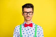 Portrait Of Attractive Calm Serious Guy Wearing Specs Print Shirt Isolated Over Bright Yellow Color Background