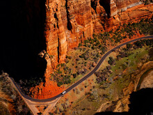Zions National Park Shuttle Bus In Canyon On Road