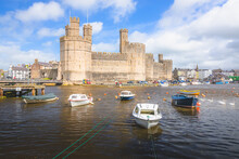 The Historic Medieval Caernarfon Castle On The River Seiont On A Summer Day In North Wales, UK.
