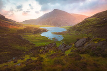 Dramatic Landscape Vista Of Cwm Idwal In The Gyderau Mountains Of Snowdonia National Park In North Wales During Sunset Or Sunrise.