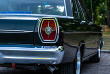 Close Up Of The Tail Light Of A Classic Car From The Sixties