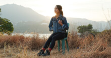 Woman Sit On The Chair And Enjoy The Sunset View