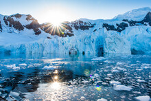 Beautiful Sunrise Between Mountains And Icebergs In Antarctica Nature Paradise Bay