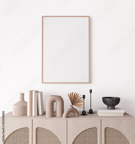 Poster frame mock up in living room interior, modern furniture and wooden decorative rattan cabinet with trendy home accessories, 3d render