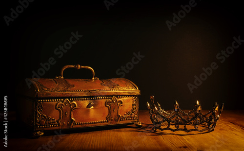 Fotografie, Obraz low key image of beautiful queen or king crown over gold treasure chest