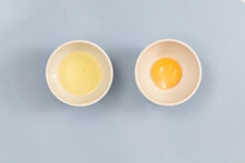 Egg Yolk In A Bowl On Blue Background
