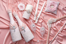 Luxurious Wedding Set Consisting Of A Pillow For Wedding Rings, A Hanger For A Bride's Dress, A Garter, Candles, Two Bottles Of Champagne And Two Crystal Glasses, Richly Decorated With Lace And