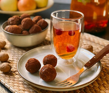 Raw Truffle Candies On A Plate With Tea.