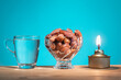 canvas print picture Muslim iftar of breaking of fast food during Ramadan month with preserved sweet dates and water. Pelita oil lamp as prop.