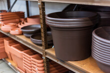 Stacked Plastic Pots For Planting At Sale In A Garden Center