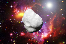 Asteroid Flying In The Deep Space. Elements Of This Image Furnished By NASA.