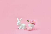 Spring Flowers In Eggshell And Porcelain Bunny. Minimal Creative Easter Concept. Festive Postcard. Selective Focus, Copy Space.
