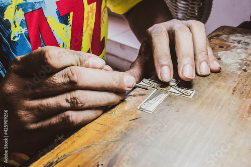 Making earrings in the foreground. Mompox, Bolívar, Colombia
