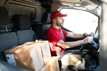 Delivery Driver Working To Deliver Parcels In A Truck