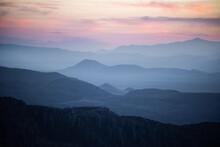 The Sun Setting Over Endless Mountain Layers In Arizona