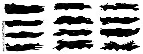 Obraz Vector collection of artistic grungy black paint hand made creative brush stroke set isolated on banner background. A group of abstract grunge sketches for design education or graphic art decoration - fototapety do salonu