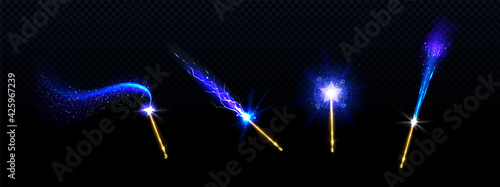 Fototapeta Magic wands with blue star and glowing sparkle trails, gold colored rods with shiny fairy dust and neon light effect trace, isolated objects on black background, Realistic 3d vector illustration, set obraz