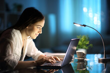 Happy Woman Writing On Laptop Keyboard In The Night