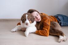 Woman Hug Beatiful Small Red Three Colours Australian Shepherd Puppy Dog