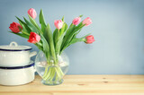Image of kitchen table with tulips flowers