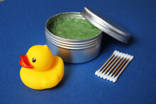 Bath Products Flat Lay. Cosmetics Set: Rubber Duck, Body Scrub In A Jar, Bamboo Cotton Sticks
