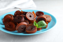 Delicious Fruit Leather Rolls On Light Table, Closeup