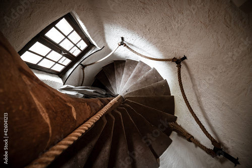 An ancient spiral staircase in a rich medieval house. Fototapet