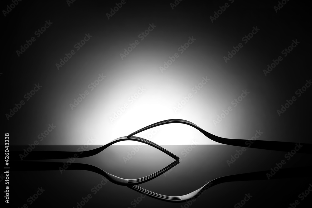 Fototapeta Creative composition with stylish forks on dark background