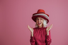 Funny, Happy Smiling Fashionable  Woman Wearing Many Hats, Posing On Pink Background. Model Looking Up. Fashion, Sale, Shopping Advertising Conception. Copy, Empty Space For Text