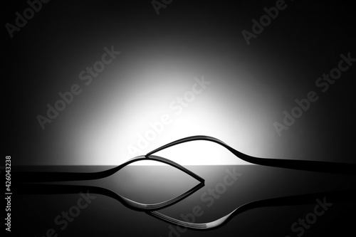 Creative composition with stylish forks on dark background