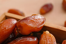 Wooden Box With Sweet Dried Dates On Color Background, Closeup