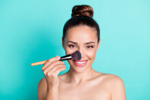 Portrait Of Attractive Trendy Cheerful Girl Applying Tone Cream Base Highlighter Isolated Over Bright Teal Turquoise Color Background