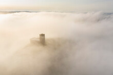 Brentor Church Surrounded By Morning Mist In Autumn, Dartmoor, Devon, England, United Kingdom