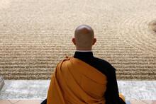 Zen Buddhist Master Practising Zazen (meditation) In Orval Trappist Abbey's Zen Garden, Belgium