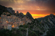 Burning Sky At Sunrise Over The Old Houses Of Castelmezzano And Dolomiti Lucane Mountains, Potenza Province, Basilicata, Italy