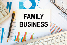 FAMILY BUSINESS Is Written In A Document On The Office Desk, Keyboard And Diagram