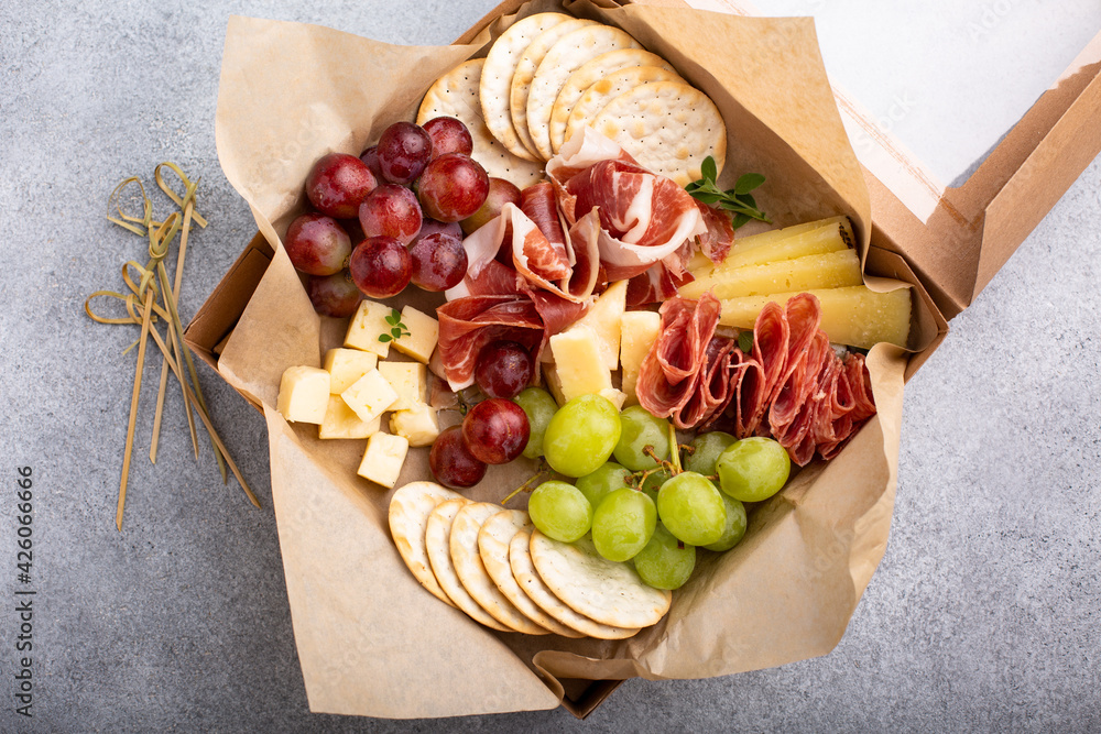 Fototapeta Charcuterie board in a box with cheese and meat