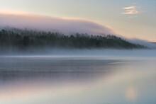 Mist Over Lake And Forest At Sunrise In Autumn, Lake Toras-Sieppi, Muonio, Lapland, Finland